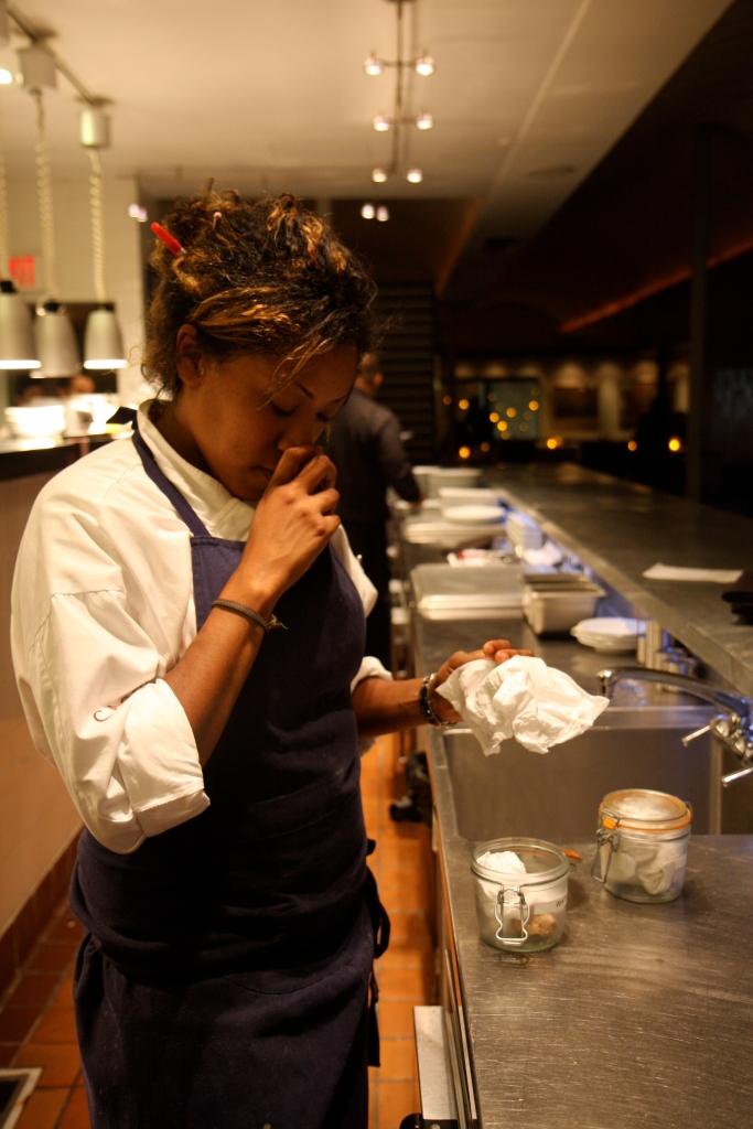 Chef Arrington checking the white truffles for dinner service